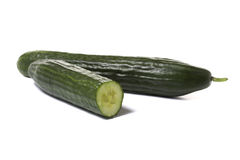 Whole and half cucumber Royalty Free Stock Image