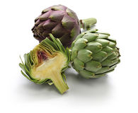 Whole and half cut artichoke stock photo