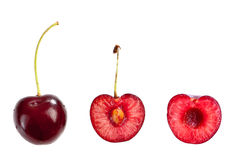 Whole and half cut cherry Royalty Free Stock Images
