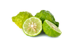 Whole and half cut fresh bergamot or Leech Lime on white. Background stock images