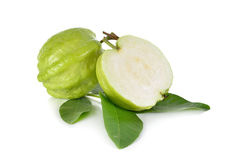 Whole and half cut fresh Guava with leaves on white Stock Image