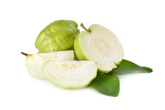 Whole and half cut fresh Guava with leaves on white Royalty Free Stock Photography