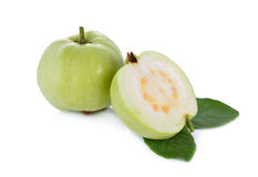 Whole and half cut fresh guava with leaves on white background Royalty Free Stock Image