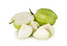 Whole and half cut fresh Guava with stem on white Stock Photography