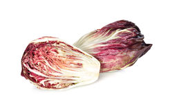 Whole and half cut fresh red radicchio on white background Royalty Free Stock Images