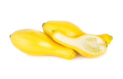 Whole and half cut fresh squash crookneck on white background Stock Photos