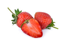 Whole and half cut fresh strawberry on white background Royalty Free Stock Image