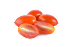 Whole and half cut fresh tomato on white background. Whole and half cut fresh tomato on awhite background royalty free stock photo