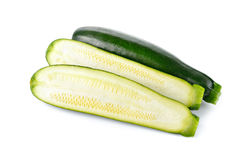 Whole and half cut fresh Zucchini on white Royalty Free Stock Images