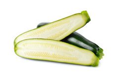 Whole and half cut fresh Zucchini on white Stock Photography