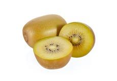 Whole and half cut gold kiwi fruit on white background Royalty Free Stock Photos