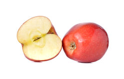 Whole and half cut red apples with stem on white Stock Photography