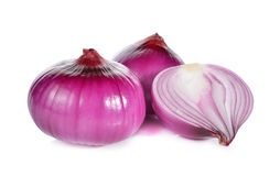 Whole and half cut red onion, shallots on white Stock Photos