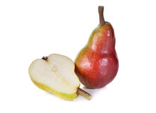 Whole and half cut red pear with stem on white Royalty Free Stock Photos