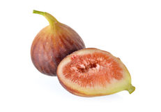 Whole and half cut ripe fig with stem on white background Stock Photo