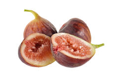 Whole and half cut ripe fig with stem on white background Royalty Free Stock Photography