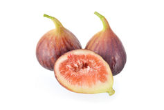 Whole and half cut ripe fig with stem on white background Stock Image