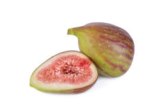 Whole and half cut ripe fig on white background Royalty Free Stock Photo