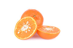 Whole and half cut ripe mandarin orange on white background Royalty Free Stock Photo