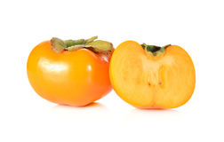Whole and half cut ripe persimmon on white background Royalty Free Stock Photography