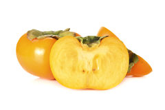 Whole and half cut ripe persimmon on white background Stock Photography