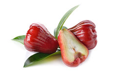 Whole and half cut rose apple on white Royalty Free Stock Photography