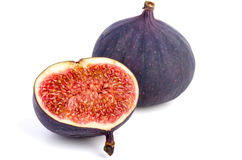 Whole and half fig. On white background Royalty Free Stock Photo