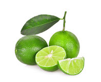 Whole and half of fresh green lime with green leaf isolated Stock Photo
