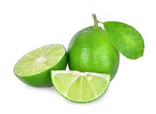 Whole and half of fresh green lime with green leaf isolated Stock Images