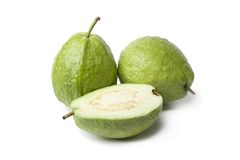 Whole and half fresh guava fruit Stock Image