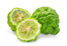 Whole and half of green fresh bergamot isolated on white. Background stock images