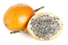 Whole and half grenadilla passion fruit isolated Stock Photo