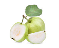 Whole and half guava fruit with green leaf isolated on white Stock Image