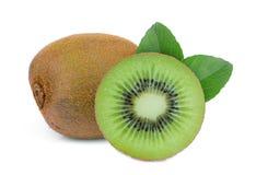 Whole and half half kiwi fruit with leaf isolated on white. Background stock photography