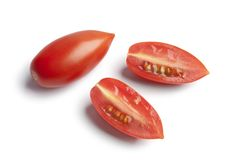 Whole and half Italian tomatoes Royalty Free Stock Photos