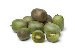 Whole and half kiwi berries Stock Photos