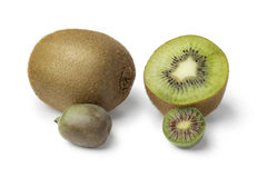 Whole and half kiwi fruit and kiwi berry Royalty Free Stock Photography
