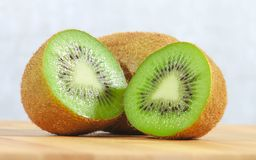 Whole and half kiwi fruit Royalty Free Stock Photos