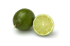 Whole and half lime fruit Royalty Free Stock Photo