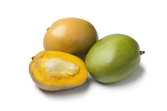 Whole and half Mango Stock Photography