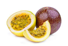 Whole and half of passion fruit isolated on white Royalty Free Stock Images
