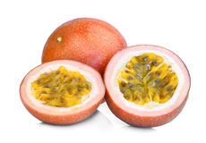 Whole and half of passion fruit isolated on white Royalty Free Stock Image