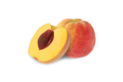 Whole and half peach with stone isolated. On white background stock image