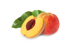 Whole and half peach with stone and leaf isolated. On white background stock images