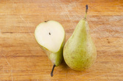 Whole and half a pear Stock Photography