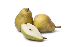Whole and half pears Stock Photos