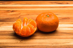 Whole and Half Peeled Tangerines Royalty Free Stock Images
