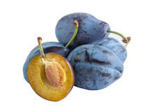 Whole and half plums Stock Image