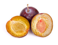 Whole and half plums Stock Photo