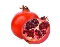 Whole and half pomegranate fruit isolated on white. Background Royalty Free Stock Photo